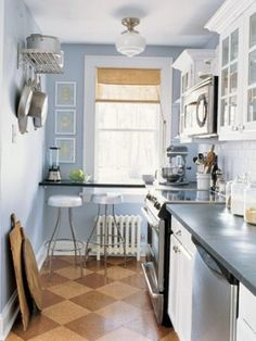 Cute. They say blue is a bad color for a kitchen because it supresses your appetite, but I think it works. It might make the room feel a little more dreamy but it also makes a small space feel larger, and it's interesting pairing it with the beige floor and vallance.