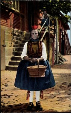 Europe | Portrait of a young woman wearing traditional clothes, Schwälmer Tracht, Hessen, Germany