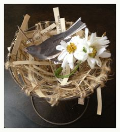 bird nest made of paper and burlap (it's all on a bed spring!)