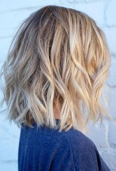 short textured hair with natural blonde highlights More