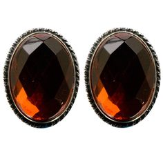 Sterling Silver Red Dark Amber Large Faceted Oval Clip-on Earrings Cabochon Size 18x25mm. Amber is organic material with healing properties. Weight of amber is traditionally calculated in grams, not carats like precious gemstones. Market value of amber is approximately the same as silver and price for finished piece of jewelry calculated by total weight of the product.