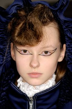 From the deepest, darkest lip colours to the return of glitter, discover autumn/winter 2016's new hair and make-up trends - from Dior, Alexander McQueen and Gucci