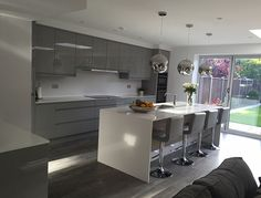 A contemporary grey gloss kitchen shown in silver grey finish. Grey Kitchen Designs, Kitchen Room Design, Luxury Kitchen Design, Kitchen Family Rooms, Living Room Kitchen, Kitchen Layout, Home Decor Kitchen, Interior Design Kitchen, Kitchen Ideas