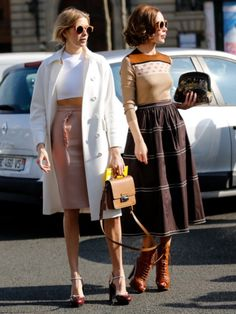 """""""hi"""" from the skirt girls...A crop top with a pencil skirt and a fitted sweater with a windowpane plaid full midi. Platform heels on both. I'd definitely hang out with these two...And look like the odd woman out, but still..."""