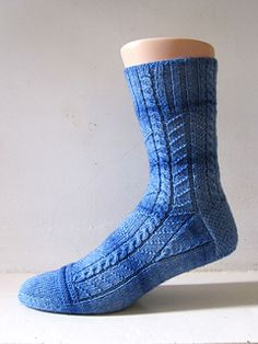 A sock inspired by classic fishermen ganseys. Apart from the main patterns, this design also tries to emulate the way the underarm gussets are shaped on close fitting sweaters to give a slighly different look to the gussets on the foot.
