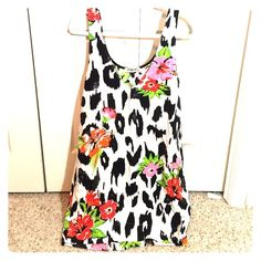 Sam & Lavi Floral Shift Dress NWT!! This floral shift dress from Sam & Lavi is a staple in anyone's closet! Please no trades or PP. Sam & Lavi Dresses Mini