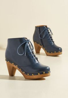 Girl, you know you've got the style smarts to rock these ModCloth-exclusive booties, so why wait another day? Lace up this navy blue pair and take their vegan faux-leather uppers, burnished gold studs, and platform heels for an astute strut through the park!