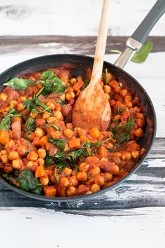 Healthy Vegan Spanish Chickpea and Sweet Potato Stew with Spinach. Simple, Healthy, Hearty and ready in under 45 minutes.