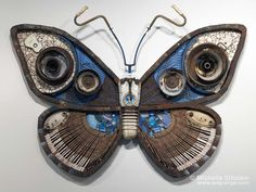 """Sulphur Blue Smeck Moth,"" 2005, made from found objects.  62""h x 84""w x 11""d  © Michelle Stitzlein  Note the bicycle handlebars as antennae."