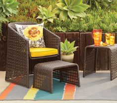 Target's 2013 outdoor collection. Small space patio set featuring a wicker chair and side table.