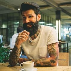 Candid of @roque 80 catching up with the #Beardbrand fam over coffee in Barcelona. 📷 by @ericbandholz #beards #beadlife