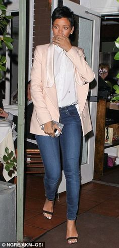 Classic look: The Diamonds singer Rihanna looked flawless in a pale peach tuxedo jacket, white shirt and blue jeans