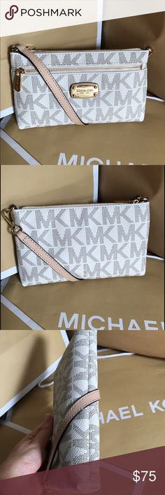 🎉Michael Kors Clutch🎉 This beautiful Michael Kors Clutch is brand new with tag!! %100 Authentic!! No trade. Color Wanilla with gold hardwear, strap is tan and removable 😂😍👀NO TRADE❌ Michael Kors Bags Clutches & Wristlets