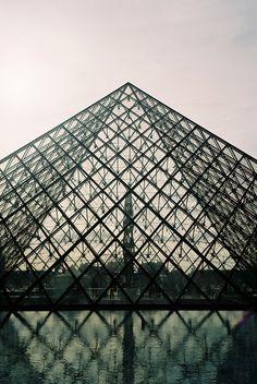 The Louvre Pyramid, designed by the architect Ieoh Ming Pei, Cour Napoléon, Louvre Palace, Paris