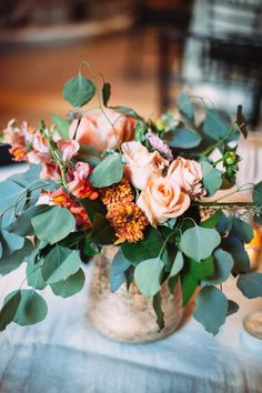 Big centerpieces filled with roses and eucalyptus leaves @myweddingdotcom
