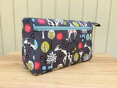 New and larger with three pockets! This giraffe diaper bag is perfect as a baby bag organizer. It is a great baby shower gift for new parents. This diaper clutch has one clear zipper pouch on the inside front, one open pocket on the inside flap and one zipper pocket on the back. The main