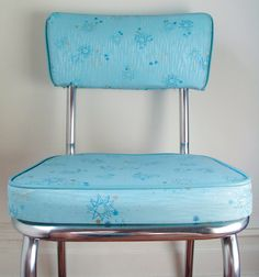 Vintage circa 1950s kitchen chairs, aqua atomic pattern.  We didnt have blue and I cant for the life of me remember the colour - maybe red?