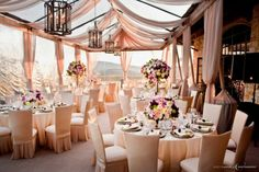 Clear Tent with Blush Pink Decor + Drapes with Gorgeous Chandeliers