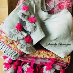 Grey and hot pink tassels Saree Blouse Neck Designs, Fancy Blouse Designs, Saree Blouse Patterns, Saree Tassels Designs, Stylish Blouse Design, Blouse Models, Passementerie, Idee Diy, Bollywood