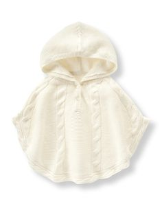 Our hooded poncho is extra cozy in a soft cotton blend. Features charming cable…