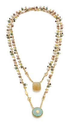 GAS Bijoux Scapulaire Serti Necklace Colorful beads embellish the chain on this polished GAS Bijoux necklace. Bold multifaceted stones finish opposite ends. This piece may be worn long or doubled, and one stone can be removed.
