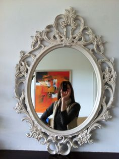 Ikea Ung Drill mirror turned vintage with a candle, spray paint and sandpaper. - Will do that with the frames I got.