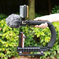 The U-Grip features a shock-proof rubber handle that alleviates stress by offering a comfortable, secure grip. U-Grip Video Action Stabilizing Handle Grip Rig Office Gadgets, Cool Tech Gadgets, Gadgets And Gizmos, Latest Gadgets, Photography Tools, Camera Nikon, Cool Toys, Filmmaking, Smartphone