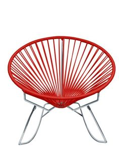 The Innit Rocker, contemporary rocking chair suitable for indoors and out. Composed of a metal base and seat woven with vinyl cord. The Innit Rocker is sim