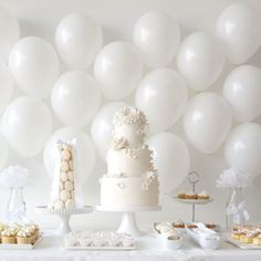 Minimalist does not have to equal boring and this all-white wedding dessert table proves it. White Dessert Tables, White Desserts, White Bridal Shower, White Baby Showers, White Party Decorations, Wedding Decorations, Baptism Table Decorations, Baptism Dessert Table, All White Party