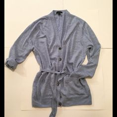 """J Crew Cardigan J Crew button down cardigan with belt. One chipped button. See pic above. Extra button available. Size medium. Two front pockets. Light blue color. 100% Merino wool. Length approx 27"""". Bust approx 41"""". Arm length approx 24"""". 15% off two items or more.  Trades  PP. Reasonable offers always welcome Free shipping with orders over $75  FREE gift  with purchase (any one $10 or under item from my closet) J. Crew Sweaters Cardigans"""