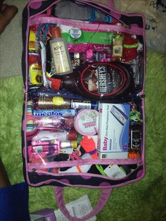 Wedding Night/ Honeymoon Night Survival Kit! It included: -17 pairs of underwear -cleansing wipes -chocolate syrup -2 energy shots -2 protein bars -KY Gel -baby oil -pack of razors -bath and body works candle -bath and body works lotion, spray, and body wash -2 pregnancy tests - 2 mini vodka, 1 tequila, 1 rum, 1 bourbon -Advil -2 mentos packs -the travel case that allowed her to zip up and go!