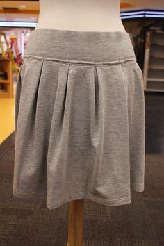 Gray pleated skirt.