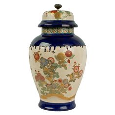 Description A Japanese Kyoto pottery vase, the body of inverted baluster form on a splayed foot with cylindrical neck, the domed cover with a broad rim and fitted with a silver (?) knop in the form of a chrysanthemum flower, the whole decorated with butterflies amid flowering chrysanthemums in overglaze enamels and gilding, the shoulder with a gossu blue border of flowing glaze, the foot with a similar band.  Date 1870-1900  www.collectorstrade.de