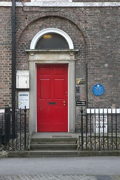 James Herriot's Red Door, Thirsk, Yorkshire, via Flickr.  I am such a fan we visited his home and surgery which is preserved to the era it was used by him.