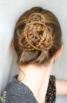 Triskelion braids!! MANY small braids bundled up into a bun.