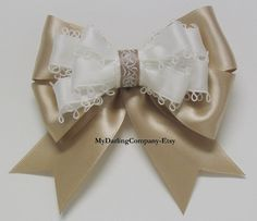 An Elegant Champagne Satin and Ivory Picot Ribbon Hair Bow with a Delicate Scroll and Vine Center. #265  Measurements: 4 3/8  across or 3 1/8