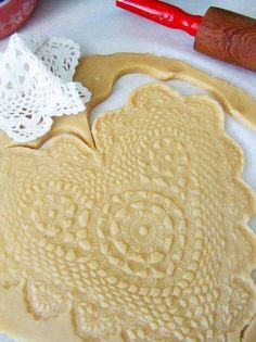 DIY Lace Patterned Pie Crust by Rolling Dough with a Lace Doily on Top of the Dough.