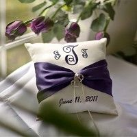 Initials and wedding date embroidered on ring pillow