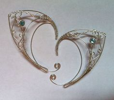 Silver Elf ears with Topaz by Alanya Divine of Belethil.