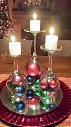 I love this idea! Put win glasses upside down, with Christmas ornaments under them, and then put small candles on top. Cute!                                                                                                                                                     More                                                                                                                                                     More
