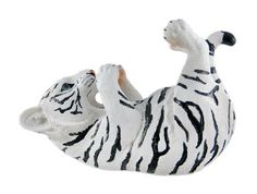 Tiger Wine Bottle Holder White by Private Label. $19.99. Hand Painted. Cold Cast Resin. Comes in a nice color gift box. Adorable white tiger wine bottle holder to add to your wildlife collection! Durable pol;y-resin material. Measures approximately H7.5'' x L11.25'' x W5.25''.