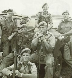 """titovka-and-bergmutzen: """" Members of what was then called """"C"""" Squadron SAS (Rhodesia) during the Malay Emergency. Future Selous Scouts founder Ron Reid-Daly is second from the right on the Rover's."""
