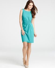 Beautiful draping on this robin's egg blue twist dress for Spring.