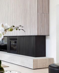 How's this for a fabulous fireplace!? Travertine and timber battens, a beautiful combo. Home in the Mornington Peninsula designed @pandolfini_architects and photo @arorygardiner . / / / / / / /  #black #blackandwhite #blackandwhiteisworththefight #travertine #travertinetile #travertinestone #timberbattens #fireplace #fireplaces #fireplacedecor #fireplacedesign
