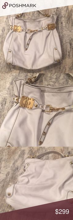 Miu Miu Off White Large Leather Satchel 15 length by 14 height by 5. Interior is in perfect condition exterior has minor signs or wear and light staining. Hefty gold toned hardware. 100% authentic. Miu Miu Bags Satchels