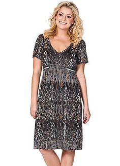 Short sleeve dress that can be worn through the day or dressed up for a night out. In a stylish wrap effect with an all-over print and v-neckline.  Wrap effect  Short sleeve  V-neckline  Washable  100% Viscose  Length from approx. 102 to 106 cm (40 to 42 ins)
