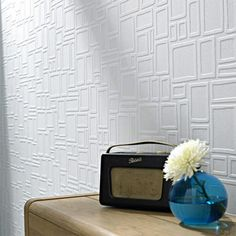 WALLPAPER THAT FIXES WALLS  A new line of wallpapers from Graham and Brown allows you cover up that disaster you call a wall. Cinderblocks, paneling, really bad cracks? These wallpapers will smooth right over them.