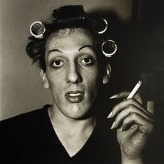 """Diane Arbus photo """"A young man with curlers at home on West 20th Street, N.Y.C."""""""