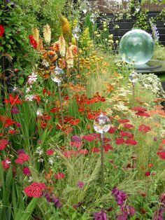 Love the planting & the glass balls that look like giant water droplets falling in the flowers