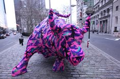 Extreme makeover of Wall Street's Charging Bull by Agata Oleksiak (known as Olek). When it comes to knit graffiti, yarn bombing or urban knitting, NYC-based artist and crochet queen Agata Oleksiak has got it all sewn up!